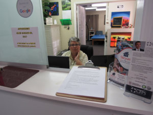 old woman on the front desk